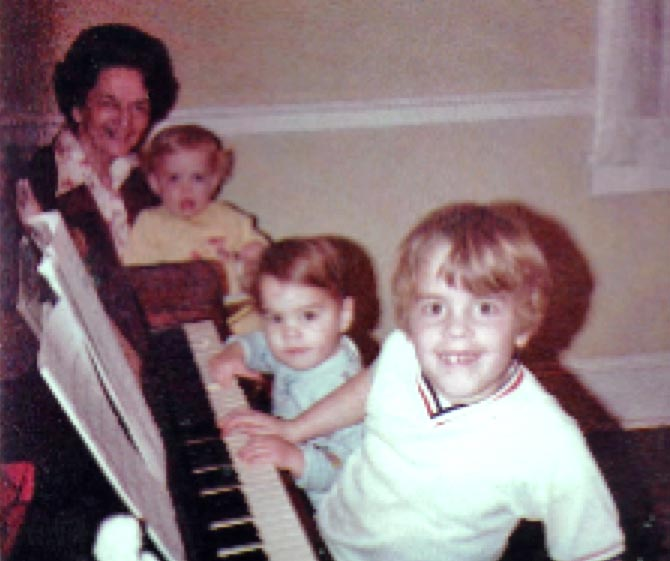 Tim at Age 7 Practicing Piano