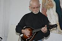Doug playing mandolin at an art gallery