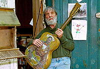 Click image for larger version.  Name:Eric with Leadbelly Guitar.jpg Views:25 Size:37.7 KB ID:194441