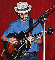 Click image for larger version.  Name:220px-Tenorguitarist.jpg Views:372 Size:19.3 KB ID:86841