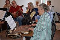 Joe Nobiling playing mandolin with the Quad City Zither Orchestra