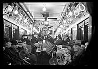 Click image for larger version.  Name:View Down Subway Car with Accordionist Performing in Aisle, New York City.jpg Views:37 Size:610.4 KB ID:181690