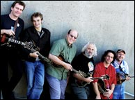 Don Stiernberg with the 2004 Mandolin Symposium instructor staff. L-R: Radim Zenkl, Chris Thile, Don Stiernberg, David Grisman, Mike Marshall, Mike Compton. Photo credit: Maria Camillo. Click to enlarge.