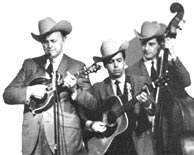 Roland playing guitar for Bill Monroe with James Monroe on bass, circa 1967-68.