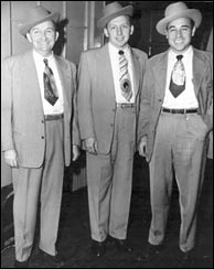 Curly Seckler (center) with Flatt & Scruggs. Click to visit curlyseckler.net. Photo credit: curlyseckler.net