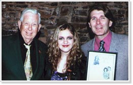 Kayla Ray (center) receives the 2009 Pearl and Floyd Franks Scholarship from Randall Franks (right), Share America Foundation president; and Joe Turner, Share America Foundation chairman. (Share America photo)