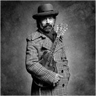 Jim McGuire studio portrait of Roland White, 1975. Click image to see enlarged version on Jim McGuire's Nashville Portraits web site.