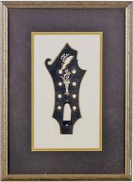 Bill Monroe's mandolin headplate, on display soon at the International Bluegrass Music Museum's Bill Monroe exhibit.