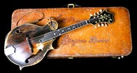 Bill Monroe's mandolin case with leather tooling by Tut Taylor was a birthday present from the Bluegrass Boys on Monroe's 75th birthday. Click to enlarge.