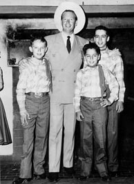 The Country Boys with Rex Allen at Riverside Rancho, Glendale, California, 1956. L-R: Eric White, Rex Allen, Clarence White, Roland White. Click to enlarge.