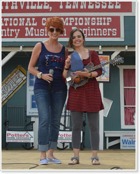 Shan Burklow presents Sierra Hull the Blue Blaze Award at the Smithville Fiddlers Jamboree, Smithville, Tenn.