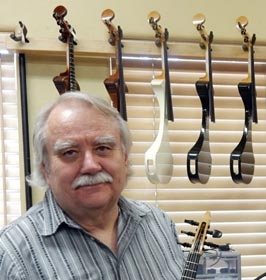 Steve Carlson, founder of Flatiron Mandolins with a few instruments from his new ZETA Violins Company
