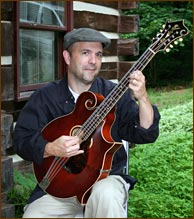 Tim May with his 1916 Gibson K4. Photo credit: Dan Miller.