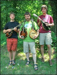 Czech riders on the mando trail, left to right, Martin Krjicek, Miroslav Vana and Jan Skovajsa, with their Vana mandolins. Click to enlarge. Photo credit: Bill Graham