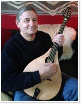 Walt Kuhlman with Gypsy's Music Rosewood Octave Mandolin to be sold at silent auction.